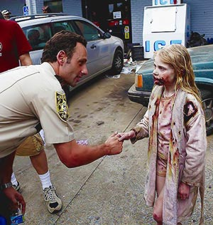 Sheriff and zombie child meet in The Walking Dead
