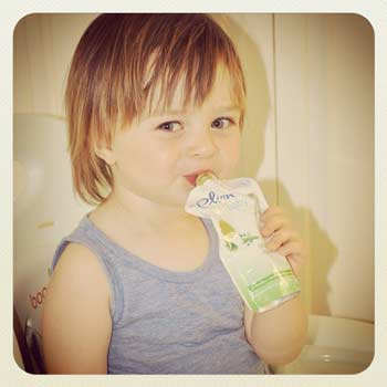 Finn eating a Plum Organics puree pouch