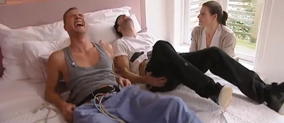 Two Men Simulate Childbirth Contractions with Electrodes